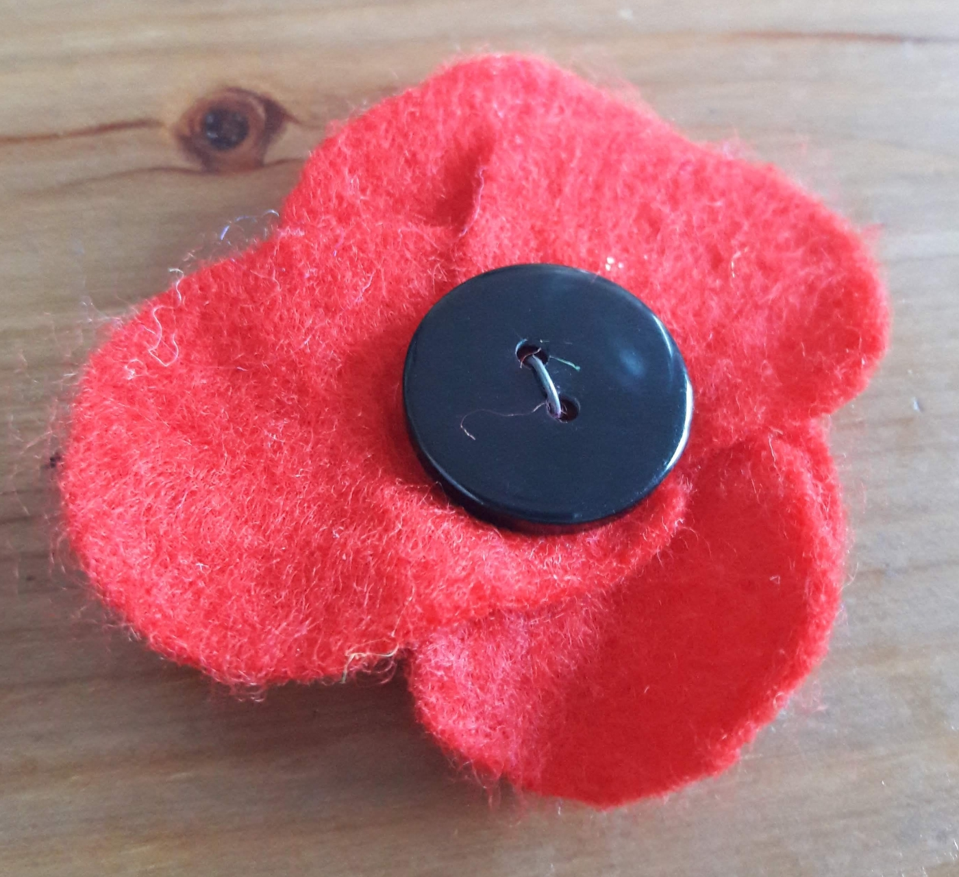 A homemade felt poppy.